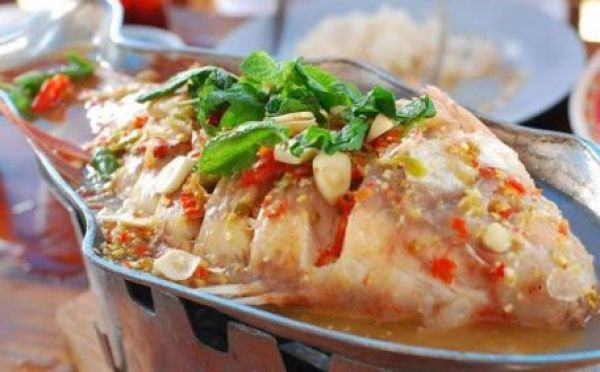 Steamed Red Tilapia fish with spiced lemon, chili &garlic sauce